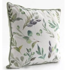 A soft to the touch and plump looking cushion featuring a charming green and blue hue and pretty printed floral design