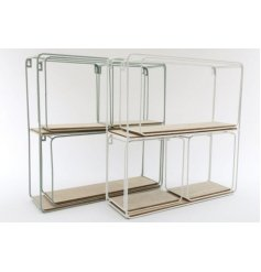 An assortment of various sized square and rectangular shaped shelving units in a white and sage green tone