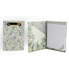 Decorated with a pretty green and blue toned floral print, this clipboard can open up to show lined pages for writing