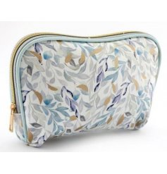 A fabric cosmetics bag set with a golden zip and pretty green and blue hued leaf print