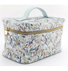 Decorated with a pretty green and blue toned leafy decal, this large vanity case also features a bold gold zip