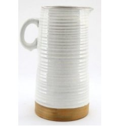 Set with a beautifully natural themed two tone colour palette, this decorative jug is sure to place perfectly in any hom