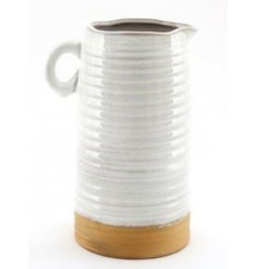 Set with a beautifully natural themed two tone colour palette, this decorative jug is sure to place perfectly in any ho