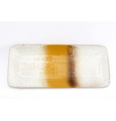 Set with a two tone speckled decal, this porcelain dish features a an ontrend colouring and added glaze effects