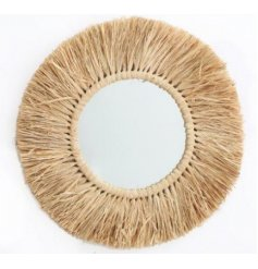 Perfect for bringing a Boho Inspired edge to your home interior, a round mirror with a dried grass surround decal