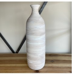 A charmingly simple tall standing stoneware vase set with a ribbed touch and natural colour tone