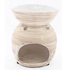 A simple themed oil burner set with a natural toned finish and ribbed decal