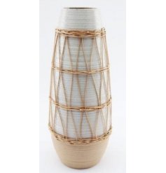 Part of the Natural Interior Range, a sleek and simple ribbed vase set with a woven rattan decal and rounded handle fini