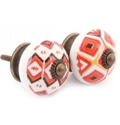 an assortment of orange toned aztec printed draw knobs with a rustic setting to each