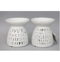 An assortment of White toned ceramic tlight oil burners with cut out text decals to each