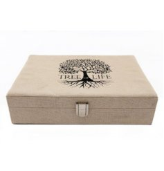 A neutral toned fabric covered jewellery box with an added Tree of Life decal on the front