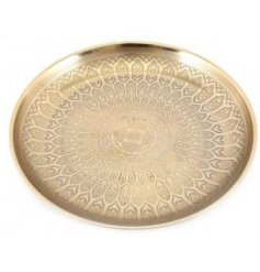 A round metal decorative bowl featuring a bold gold tone and etched decal