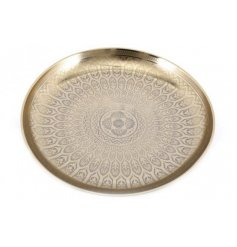 a round metal decorative bowl featuring a bold golden tone and etched decal