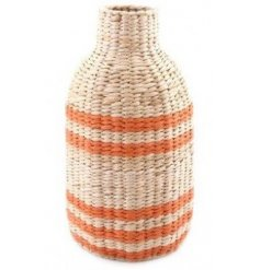 Sure to bring a trewnding touch to any home space, a natural woven paper based decorative vase