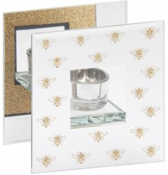 A glitzy and glam themed glass tlight holder with an added mirrored decal and golden bees