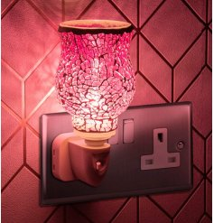 A plug in powered Desire Aroma Dispenser with a beautiful mosaic pink decal and glow