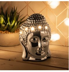 A buddha inspired Aroma Wax Burner with a warm glowing LED Centre and sleek chrome inspired tone