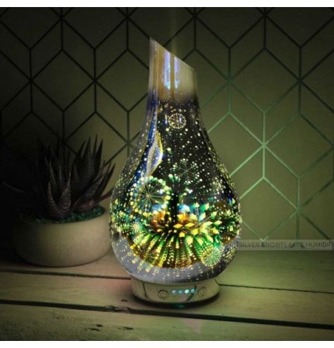 A warm glowing LED Glass Humidifier featuring a beautifully illustrated Snowflake scene