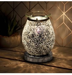With a beautiful mosaic crackle effect surround, this Desire Aroma Lamp is sure to place perfectly in any home space