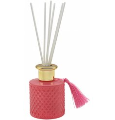 A sweetly scented aroma diffuser set with a diamond ridge decal, pretty pink tone and added vintage tassel for charm