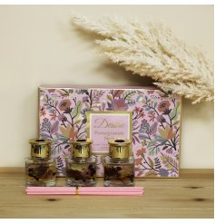 A charming set of reed diffusers filled with colourful floral features