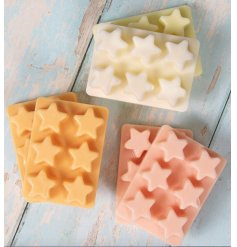 An assortment of individually packaged Wax Melt Packs in Star Shapes