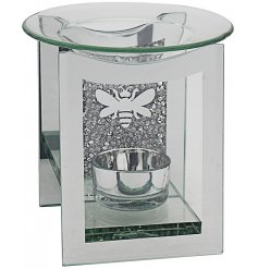 A square shaped glass tlight holder set with a crystal inspired backing and a charming silver bee print