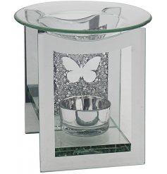 A gorgeously decorated glass tlight holder complete with a crystal inspired backing and charming silver butterfly centra
