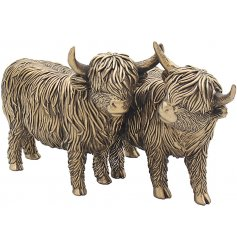 Sure to bring a delightful Country Charm feel to any home space, a pair of highland cow ornaments in a bronzed tone
