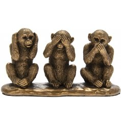 3 beautiful bronzed wise monkeys in the see, speak and hear position.
