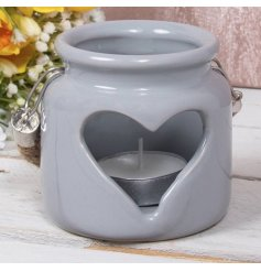 A sweet and simple grey ceramic tlight holder complete with a heart cut detail and chunky rope handle
