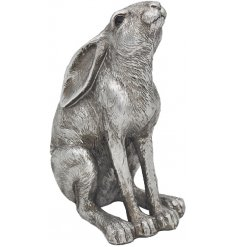 A gazing posed ornamental hare decorated with realistic features and set with a rustic silvered tone