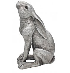 A moon gazing posed ornamental hare decorated with realistic features and set with a rustic silvered tone