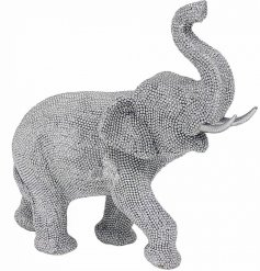 A gorgeously glitz themed elephant ornament set with a silver tone