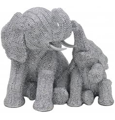 An adorable posed mother elephant and baby calf ornament covered with a glitzy glitter shimmer