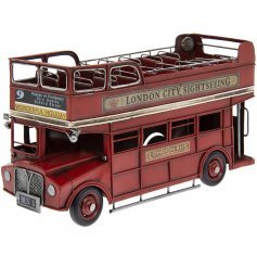 A vintage Topless London Bus ornament complete with realistic features and a distressed finish