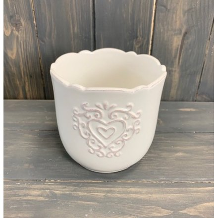 Sure to add a Shabby Chic edge to any home interior, a tulip edged pot featuring an embossed heart decal