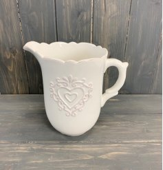 Sure to add a Shabby Chic edge to any home interior, a tulip edged jug featuring an embossed heart decal