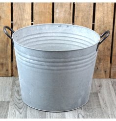 A large rounded zinc bucket featuring a ribbed decal and dark toned handles for easy movement