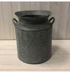 Perfect for displaying artificial blooms in and around your home, a distressed metal churn with a trendy geometric embo