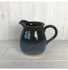 A decorative stoneware jug covered with a reactive blue glaze coating