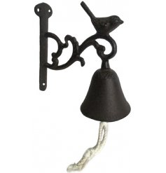 An elegant cast iron scroll designed door bell with rope handle and decorative bird sitting on the top.