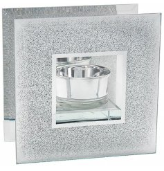 A glitzy and glam themed glass tlight holder with an added mirrored back and chic look