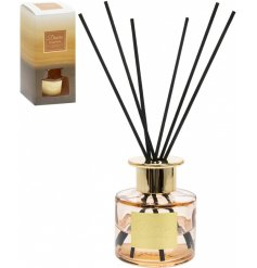 this orange toned reed diffuser also features golden accents and a stunning gift box to match