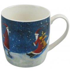A festive themed porcelain mug featuring a sledding Santa decal