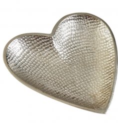 A silver aluminium heart shaped dish with hammered effect.