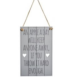 A small wooden plaque printed with a comical scripted text decal