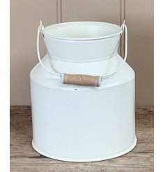 Set with a matte cream tone coating, a small decorative zinc churn sure to place perfectly in any home space with a coun