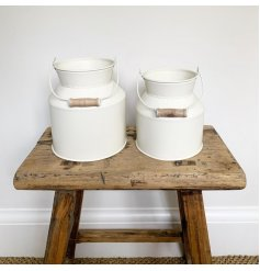 a small decorative zinc churn sure to place perfectly in any home space with a country charm theme
