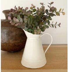 A simplistic decorative metal jug set with a ridged decal and matte cream tone, perfect for filling with artificial bloo